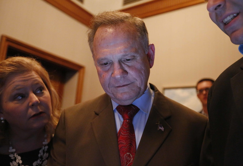 Republican U.S. Senate candidate Roy Moore, center, looks at election returns with staff during an election-night watch party at the RSA activity center, Tuesday, Dec. 12, 2017, in Montgomery, Ala.