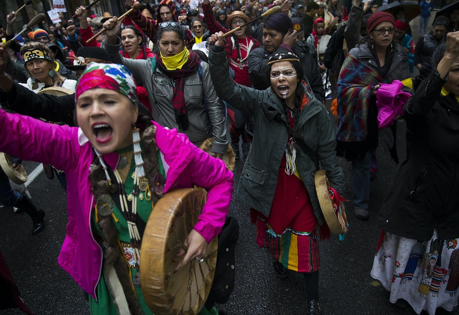Mariana Harvey, left, and Leslie Jimenez, center, lead the Indigenous People's Day march and celebration on Monday, October 8, 2018, on 5th Avenue in Seattle.