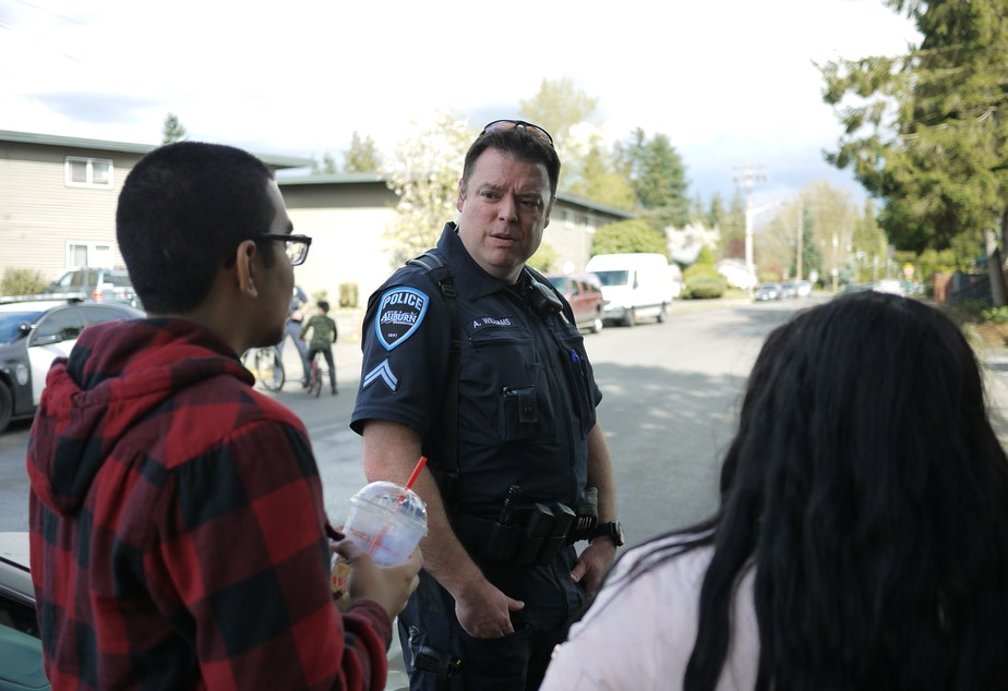 File photo. Auburn police talk to residents.