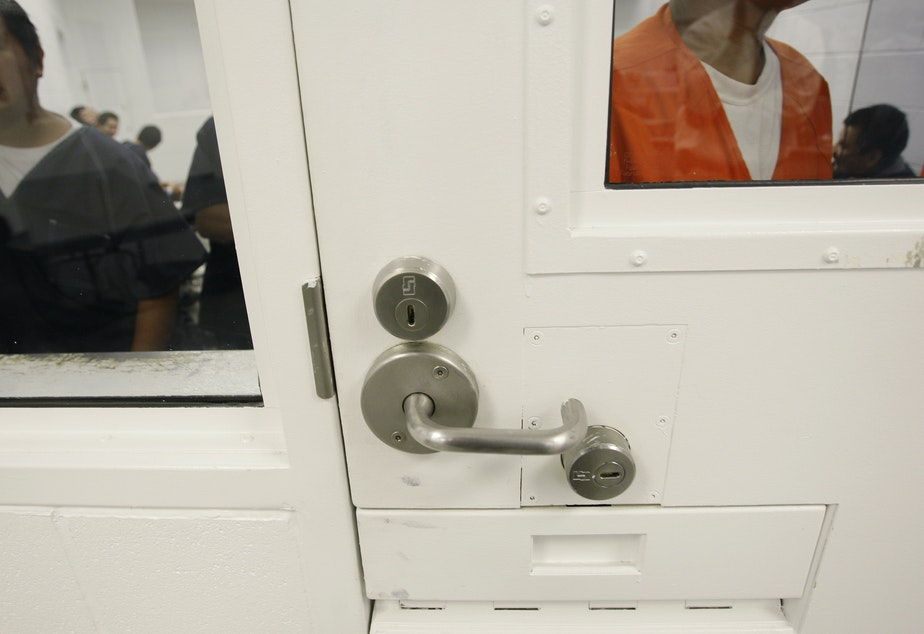 caption: Detainees at the Northwest Detention Center in Tacoma