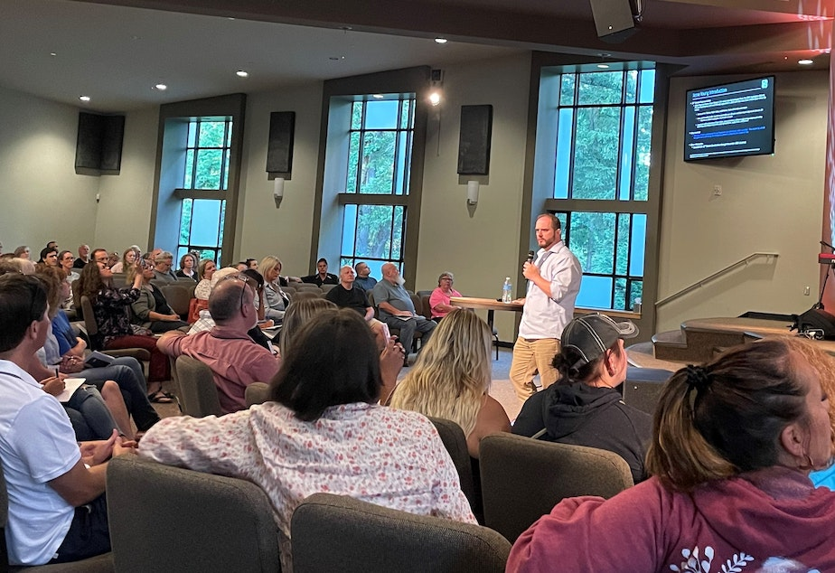 caption: GOP State Rep. Jesse Young speaking at a One Washington event at Island Church on Bainbridge Island, Sept. 8, 2021.