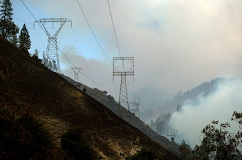 Power lines are seen through smoke from the Camp Fire near Pulga, Calif., on Sunday.