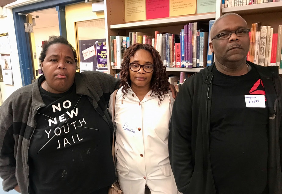 caption: K.L. Shannon (far left), and Denise Dailey and Tim Dailey want answers from Seattle Public Schools about why a teacher known to be abusive was hired at Washington Middle School — where, they said, he harmed their boys, too.