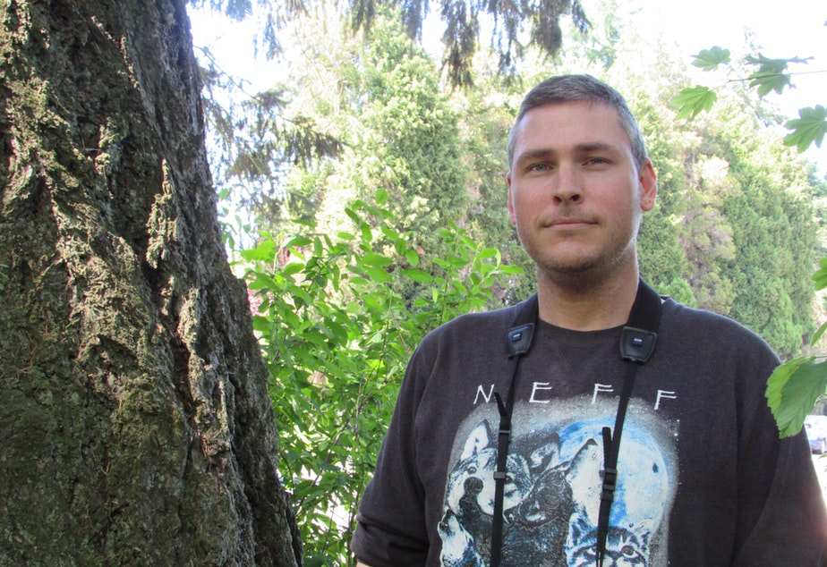 caption: Joshua Morris with Seattle Audubon says Seattle's big trees are vital and there is currently no penalty for removing them.