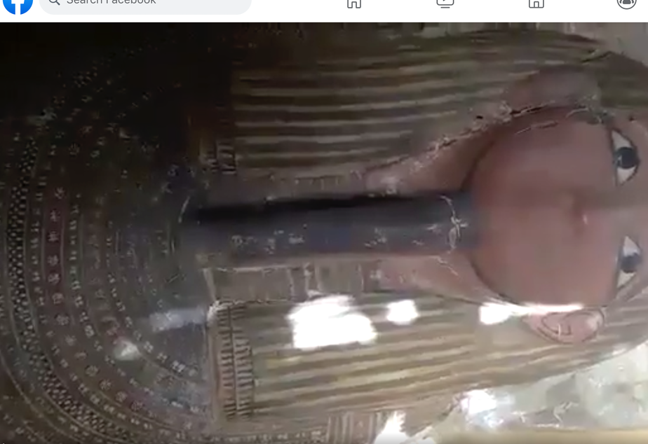 caption: Screenshot of video on Facebook showing an Egyptian sarcophagus with mummy inside for sale. According to the ATHAR Project, the video is from an area known for extensive antiquities looting. Facebook bans trade in antiquities and human remains, but relies on user reports to flag suspect items. This post, reported by ATHAR using the Facebook system, was not deemed to violate Facebook's standards.