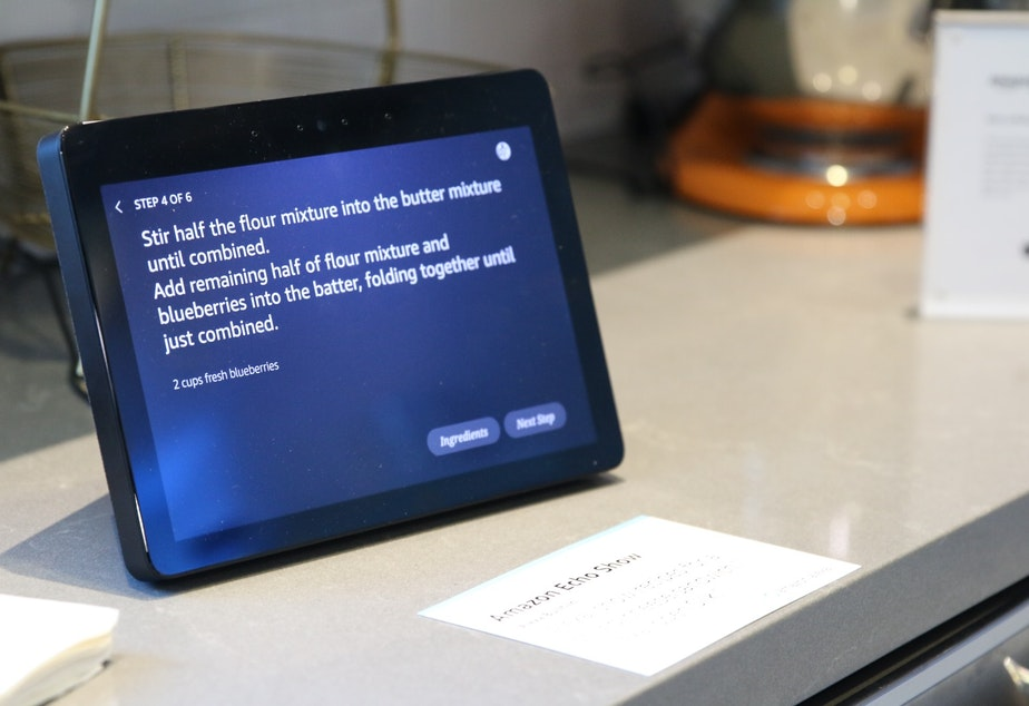 An Echo Show guides Joshua through a recipe at Amazon's secret smart home lab in the Amazon Day One building.