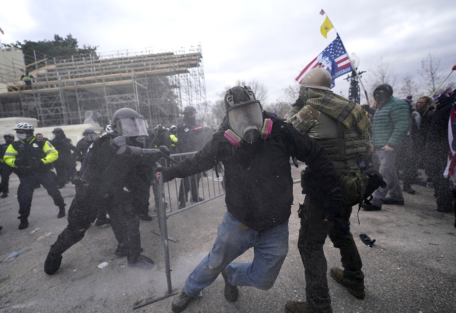 caption: Trump supporters try to break through a police barrier, Wednesday, Jan. 6, 2021, at the Capitol in Washington. As Congress prepares to affirm President-elect Joe Biden's victory, thousands of people have gathered to show their support for President Donald Trump and his claims of election fraud.