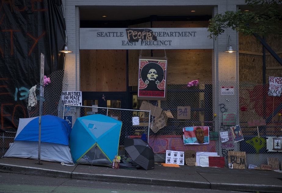 caption: The exterior of the Seattle police department's East Precinct building is shown on Saturday, June 13, 2020, in Seattle.
