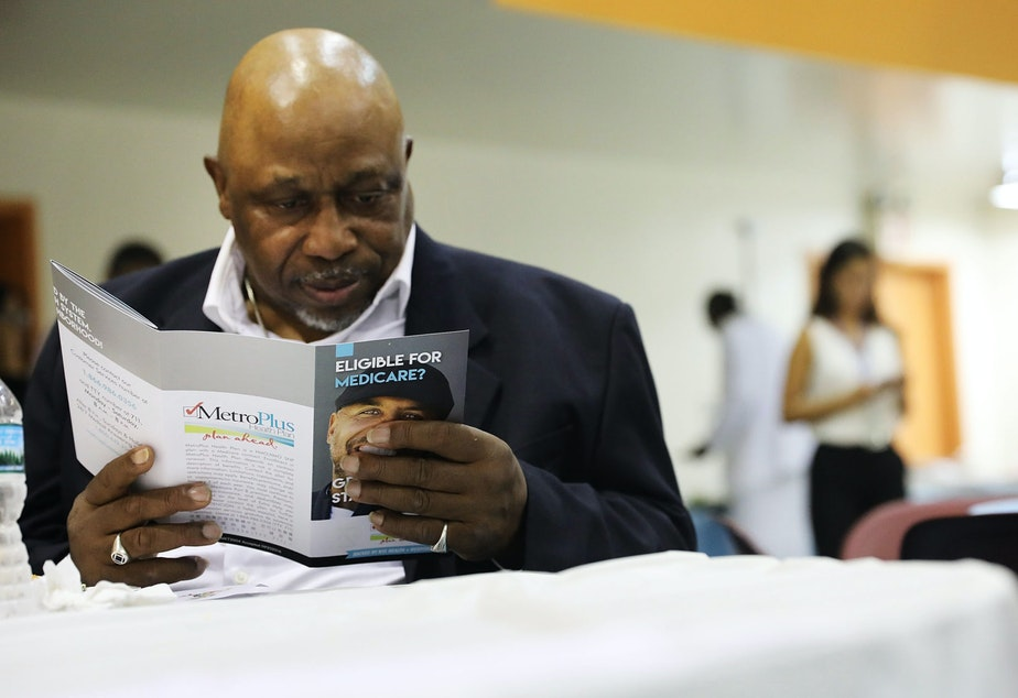 A man reads literature on Medicare at an event sponsored by MetroPlus, a prepaid health services plan, on June 23, 2017 in New York City. The Harlem seniors were provided with Medicare education and health care options at the event. (Spencer Platt/Getty Images)