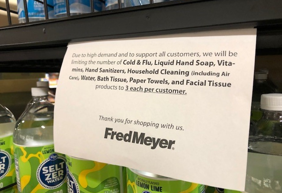 caption: A sign at a Seattle Fred Meyer amid the local COVID-19 outbreak.