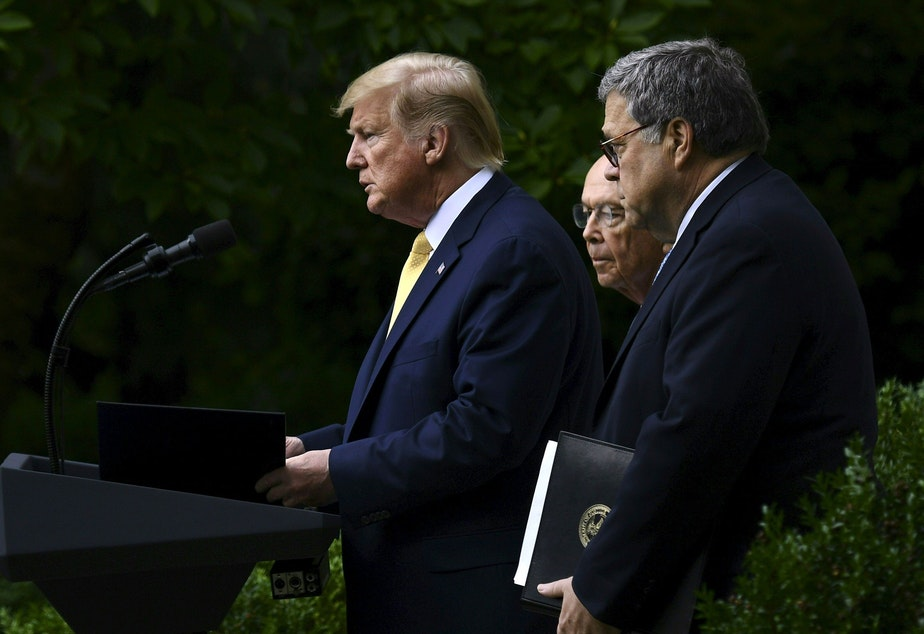 President Trump, flanked by Commerce Secretary Wilbur Ross (back) and U.S. Attorney General William Barr, delivers remarks on citizenship data in the Rose Garden at the White House in Washington, D.C., in July.
