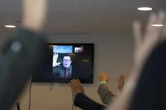 Pastor Carlos Galdamez is shown on Skype during a church service in the basement of Nathan Roberts' home, on Sunday, September 16, 2018, in Des Moines.