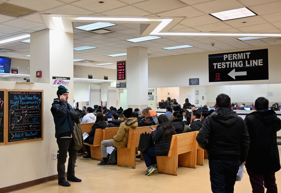 caption: DMV offices around the U.S. were slowed down for hours on Monday, due to a network outage in a key database. Here, people wait at the New York State Department of Motor Vehicles office in  Brooklyn last month.