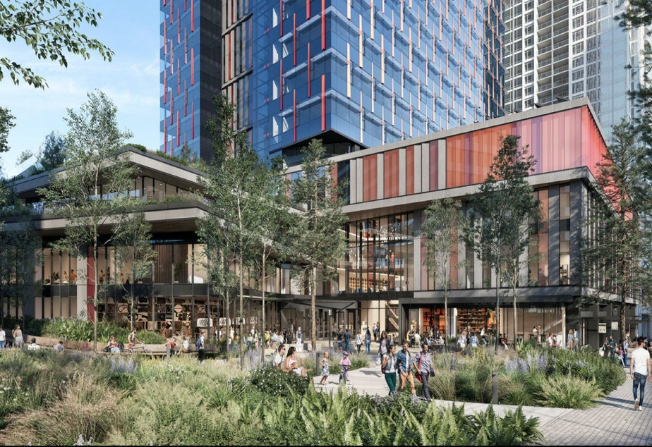 caption: The base of Amazon's proposed office tower in Bellevue, with an open space facing the Grand Connection