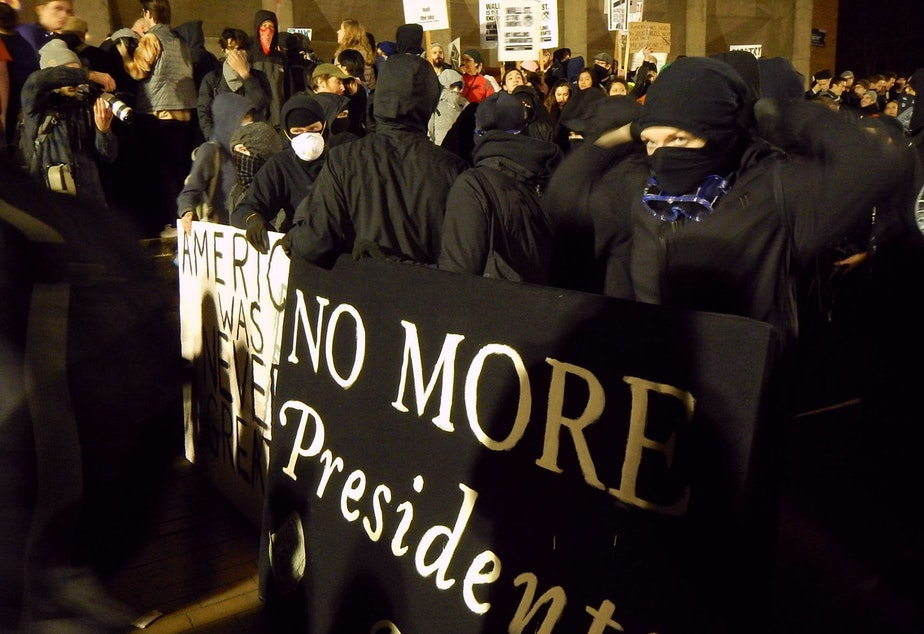 caption: Protesters crowd into the University of Washington's Red Square on Friday, January 20, 2017 during a speech by Breitbart editor Milo Yiannopoulos.