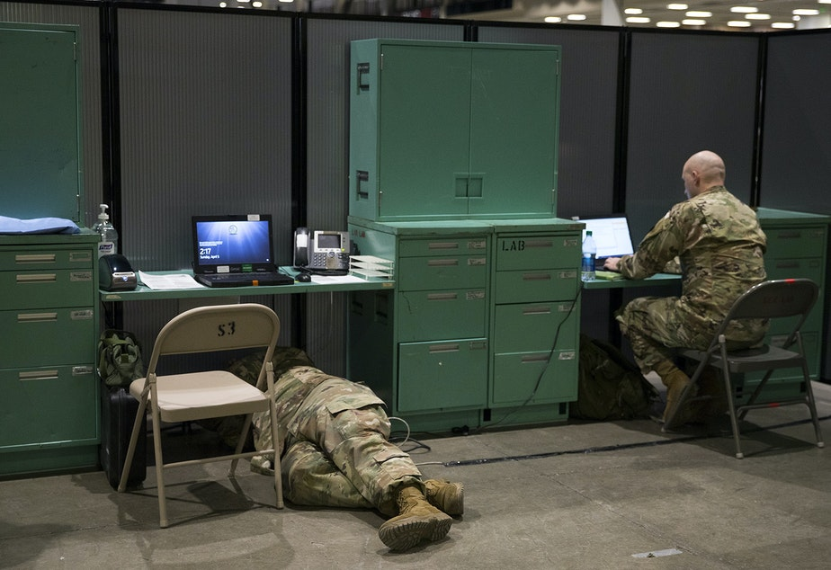 caption: U.S. Army soldiers set up the laboratory area of a military field hospital inside CenturyLink Field Event Center on Sunday, April 5, 2020, in Seattle. The 250-bed hospital for non COVID-19 patients was deployed by soldiers from the 627th Army Hospital from Fort Carson, Colorado, as well as soldiers from Joint Base Lewis-McChord.