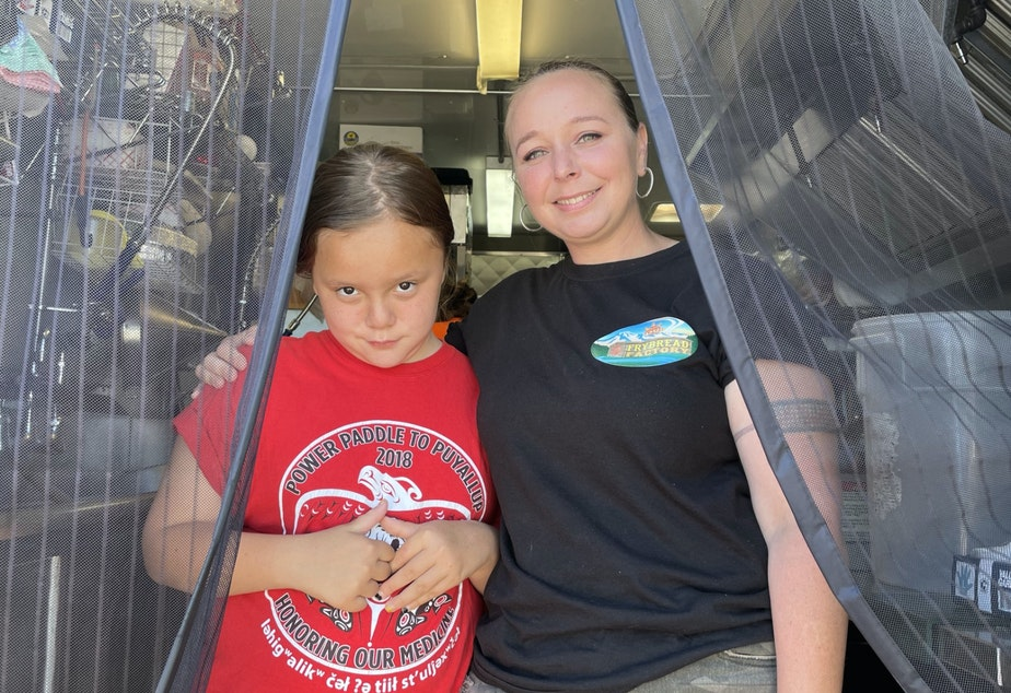caption: Katie Miles and her daughter Judith in their food trailer. Together they make and sell frybread.