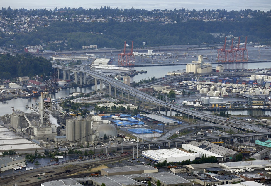 caption: In this aerial photo taken Aug. 2, 2014, the Port of Seattle, the West Seattle Bridge, and the Ash Grove Cement Company (left) are shown.