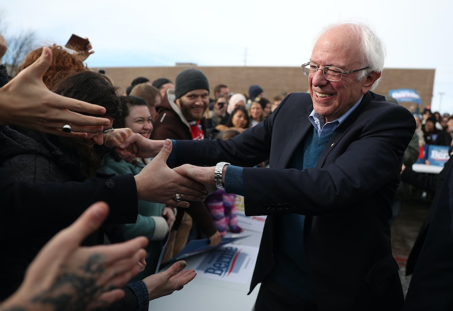 caption: Vermont Sen. Bernie Sanders greets people at a campaign field office in Cedar Rapids, Iowa. Sanders is the slight favorite to win the caucuses, and he hopes it vaults him to the Democratic nomination.