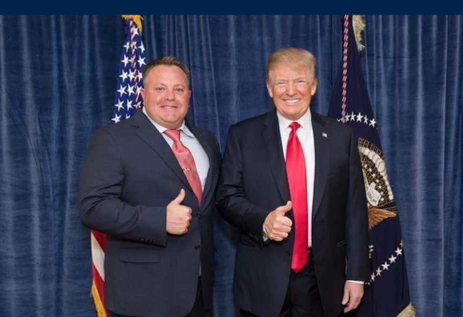 caption: Robert Hyde posing with President Trump. Hyde has emerged as the latest figure in the impeachment saga following the release of messages in which he discusses surveillance of former U.S. Ambassador Marie Yovanovitch.