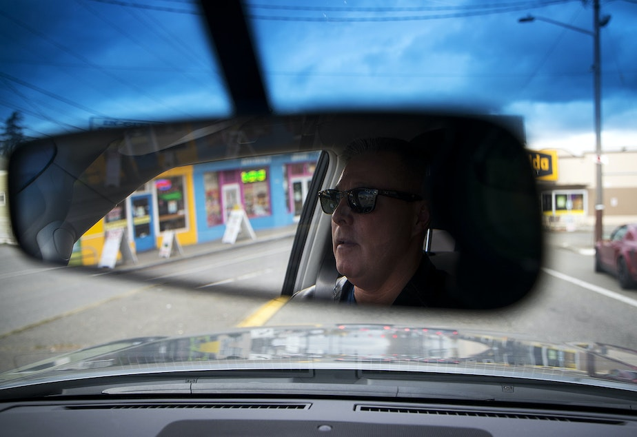 caption: Sgt. Tom Umporowicz drives along Aurora Avenue North on Wednesday, March 28, 2018, in Seattle.