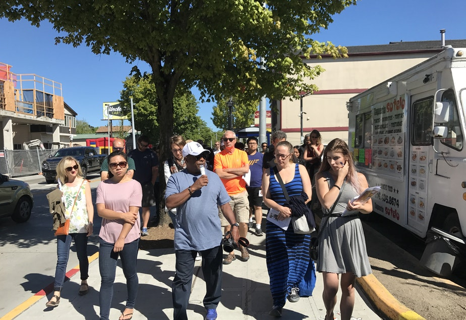 Tour leader and architect Donald King points out Central District buildings that were built with - and without - community involvement.