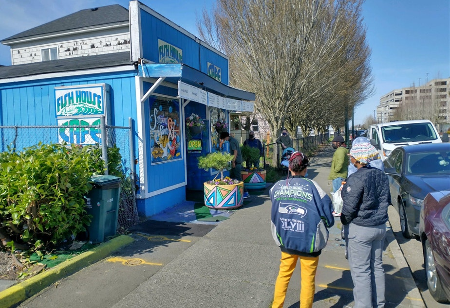 caption: Customers line up outside the Fish House Cafe on MLK Jr Way in Tacoma's Hilltop neighborhood
