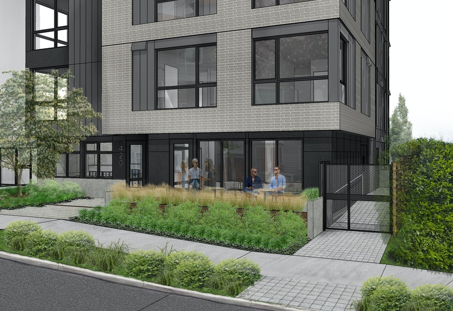 caption: An illustration of the new apartments at John Street and Broadway in Seattle's Capitol Hill neighborhood. The apartments were purchased by the city to house people experiencing homelessness.