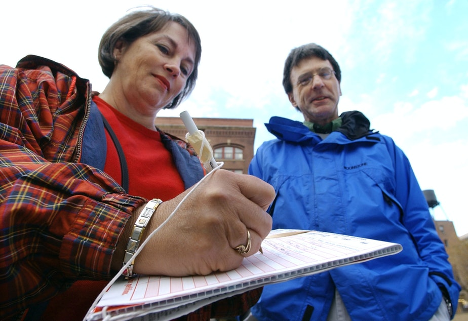 caption: Mary Champine, left, adds her signature to a petition in Washington state (file photo).
