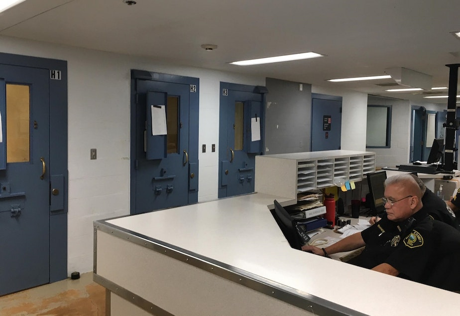 caption: Temporary holding cells in the booking area of the Mason County Jail are used to house higher-risk inmates because of a lack of individual cells in the 35-year-old facility.