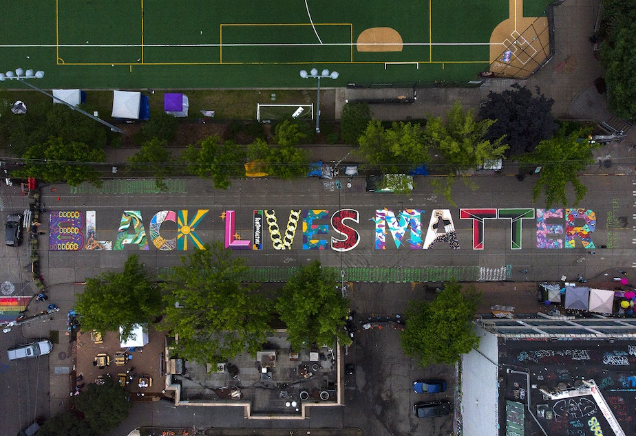 caption: FILE: The block-long Black Lives Matter street mural, beginning at 10th Avenue and East Pine Street, is shown on Saturday, June 13, 2020, inside the area known as the Capitol Hill Occupied Protest, or CHOP, in Seattle.