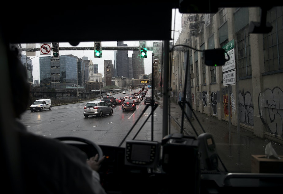 caption: A view of Seattle is shown through the windshield of Sound Transit bus 594 on Wednesday, January 22, 2020.