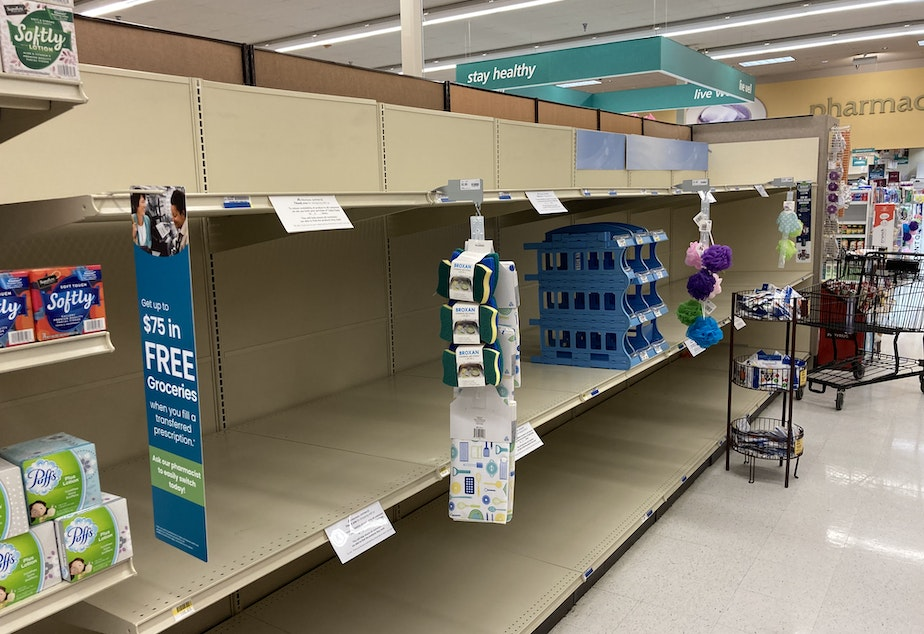 caption: Toilet paper is sold out at a Safeway store in Tumwater, Washington. A wave of 'panic buying' followed news that Gov. Jay Inslee was instituting tough new restrictions to address a third wave of Covid-19.