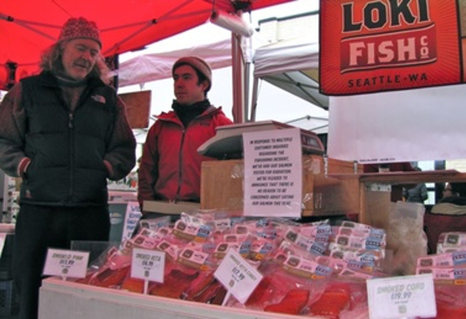 "caption: Pete Knutson and his son Dylan sell wild salmon at farmers markets around Seattle. ""We had people passing on our fish this year. It was directly because they were worried about Fukushima,"" Pete Knutson said."