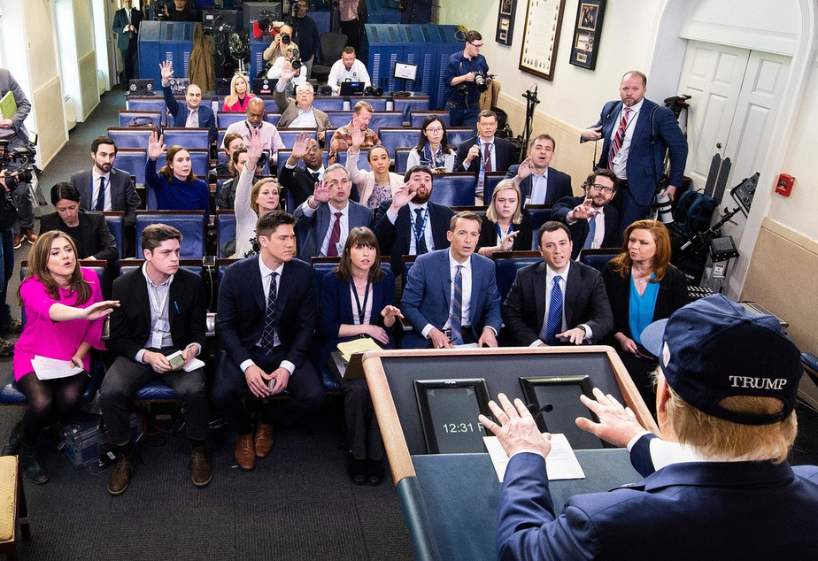 caption: President Trump takes questions from reporters on Saturday. The White House is holding daily briefings to explain how the administration is dealing with the spread of coronavirus.
