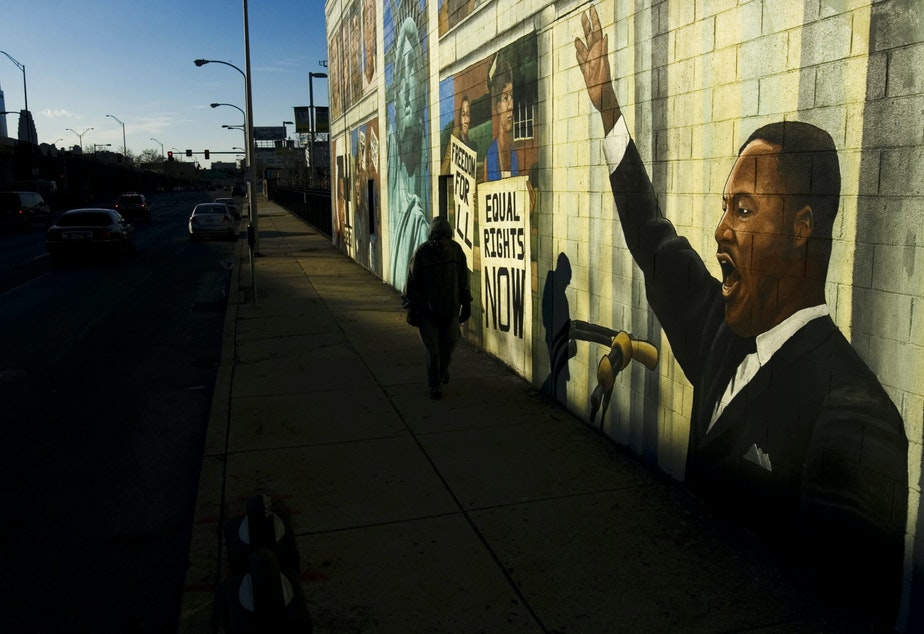 caption: A person walks past a mural of Martin Luther King in Philadelphia, Friday, Jan. 18, 2008. Monday, Jan. 21, 2008 is Martin Luther King Day. (Matt Rourke/AP)