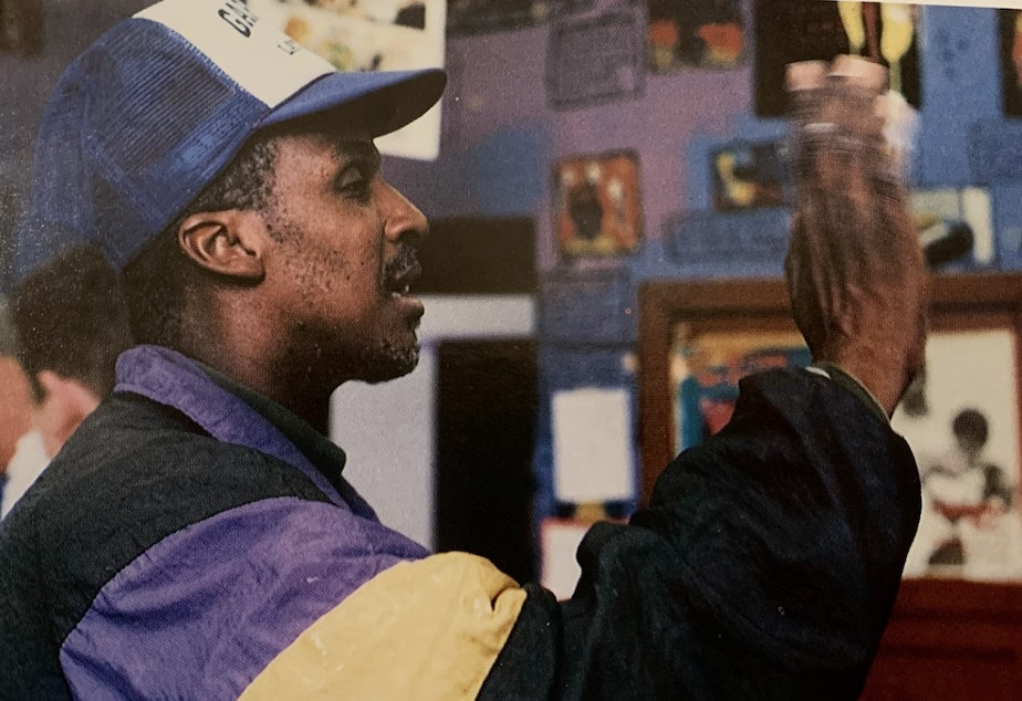 """caption: Wendell """"Rick"""" Hicks waves goodbye to the class of 1998 in this yearbook photo from the Garfield High School Arrow."""