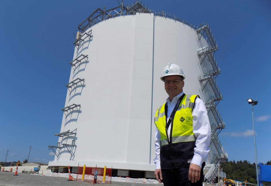 Puget Sound Energy spokesperson Andy Wappler in front of the company's 8 million gallon liquid natural gas tank in Tacoma.
