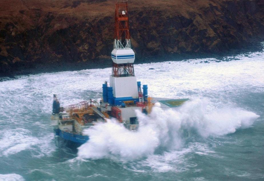 caption: Shell's Kulluk oil rig aground on Alaska's Sitkalidak Island in Jan. 2013.