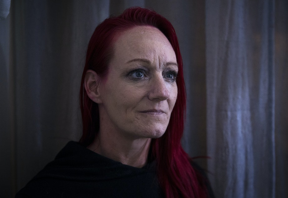 caption: Robin Curtis in her room at a downtown Seattle shelter on Friday, November 15, 2019.
