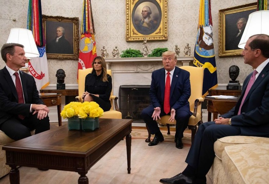 President Trump speaks to the press with First Lady Melania Trump and Health and Human Services Secretary Alex Azar (right) and acting Commissioner of the Food and Drug Administration Norman Sharpless (left) in the Oval Office at the White House Wednesday to announce a proposed ban on flavored vaping products.