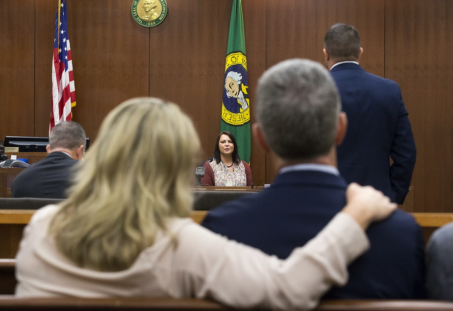 caption: Laura Baanstra, center, testifies at the trial of William Earl Talbott II on Friday, June 14. Talbott has been charged with killing her brother, Jay Cook, and his girlfriend Tanya van Cuylenborg in November of 1987. In the foreground: May Robson, left, Tanya's best friend, and John van Cuylenborg, Tanya's older brother, watch Baanstra's testimony.