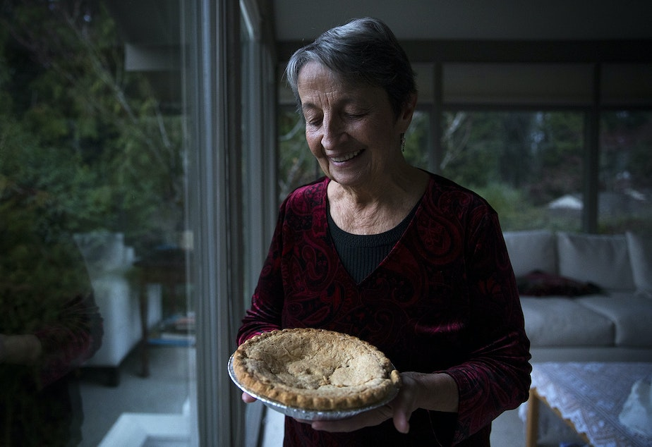 caption: Sheila Kelly holds a mincemeat pie bought by her mother, Helen May Kelly, in 1988, on Friday, November 22, 2019, at her home in Seattle. Her mother died before the pie could be consumed and she has kept it in her fridge ever since.