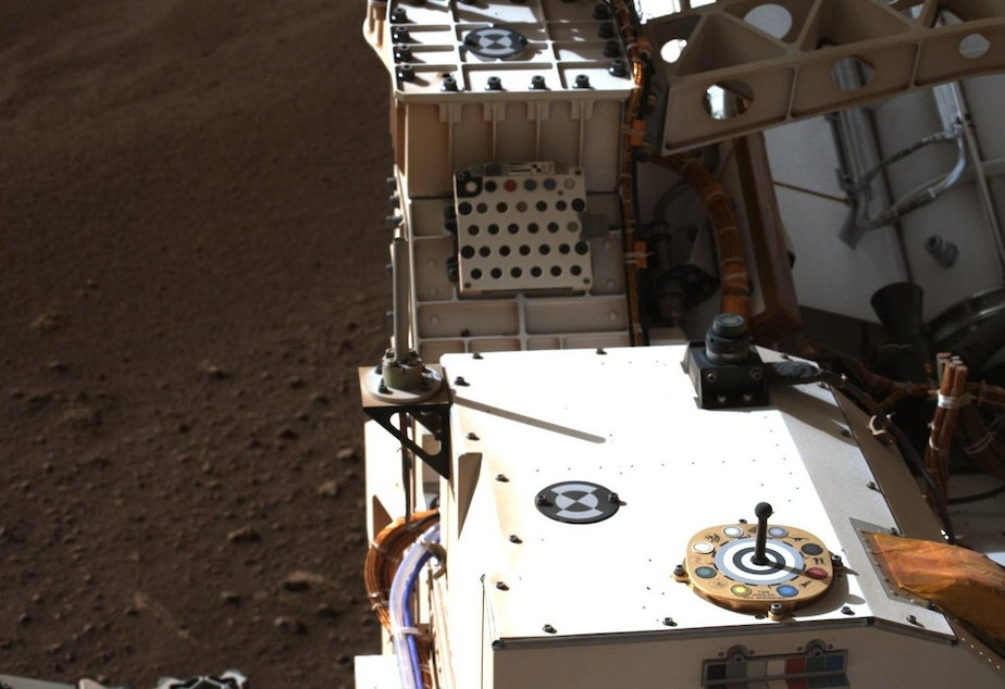caption: This photo of the Rover includes a view of color chips used to calibrate the images from Mars.