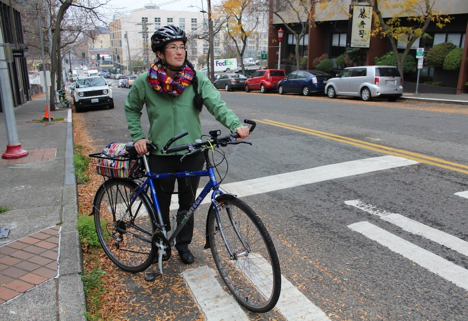 Clara Cantor of Seattle Neighborhood Greenways is one of many stakeholders weighing in as the city's network of protected bike lanes takes shape. Cantor  stands at the top of a long uphill climb on S Main Street. It's part of the city's preferred route for bikes leaving downtown bound South Seattle.