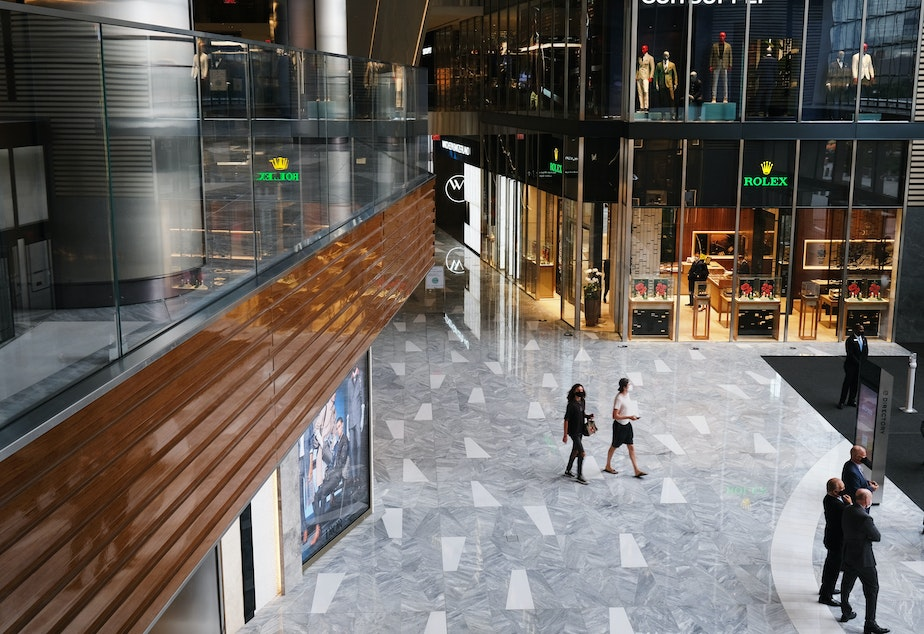 caption: People walk through the newly reopened mall at Hudson Yards in New York. U.S. shoppers spent more prudently in August and retail sales grew a tepid 0.6% from July.