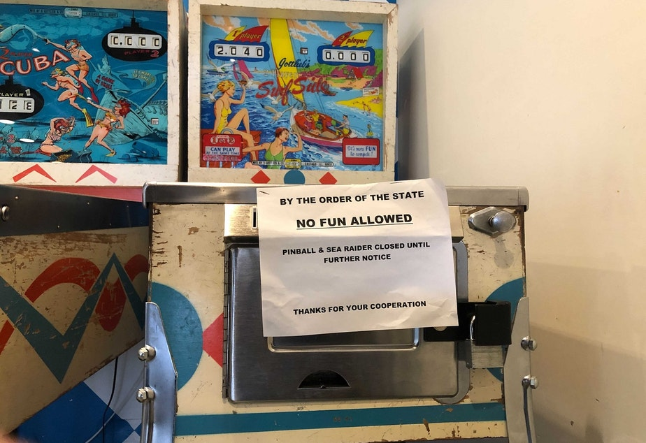 caption: A sign on the pinball machine at Spuds near the ferry terminal in Edmonds, Washington, on November 20, 2020.