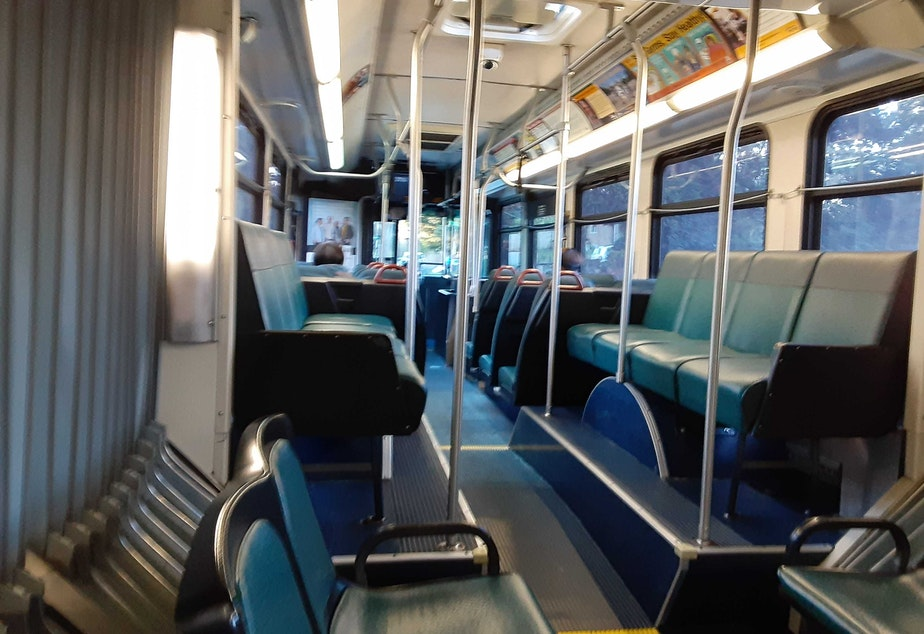 caption: A King County Metro bus in Seattle on Monday, March 16, 2020. The first weekday after Gov. Jay Inslee ordered no public gatherings more than 50 people, and also shut down restaurants and bars statewide in response to the COVID-19 outbreak.