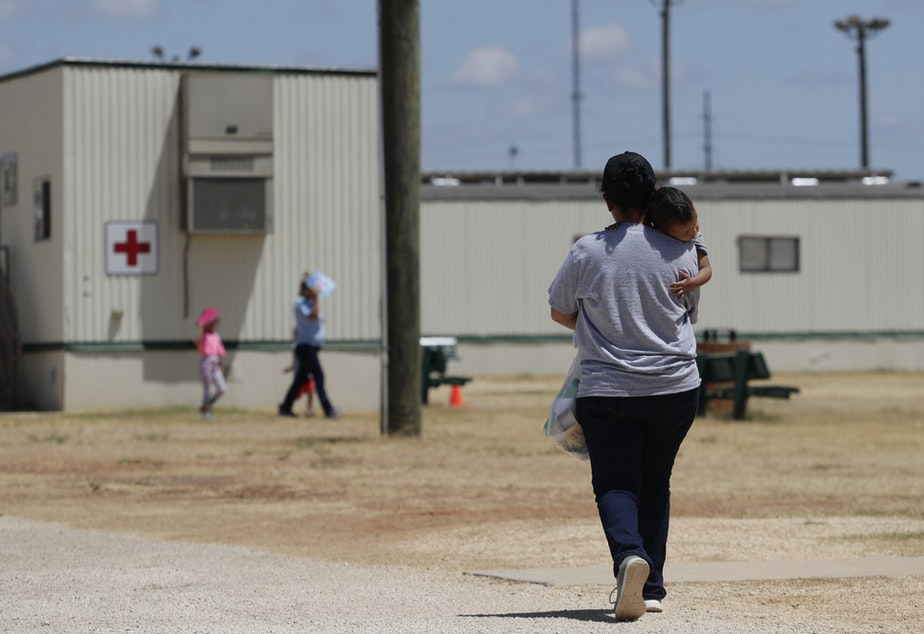 caption: Immigrants seeking asylum are seen last year at the ICE South Texas Family Residential Center in Dilley, Texas. A federal judge on Wednesday ordered the Trump administration to stop expelling immigrant children who cross the southern border alone as an anti-coronavirus measure.