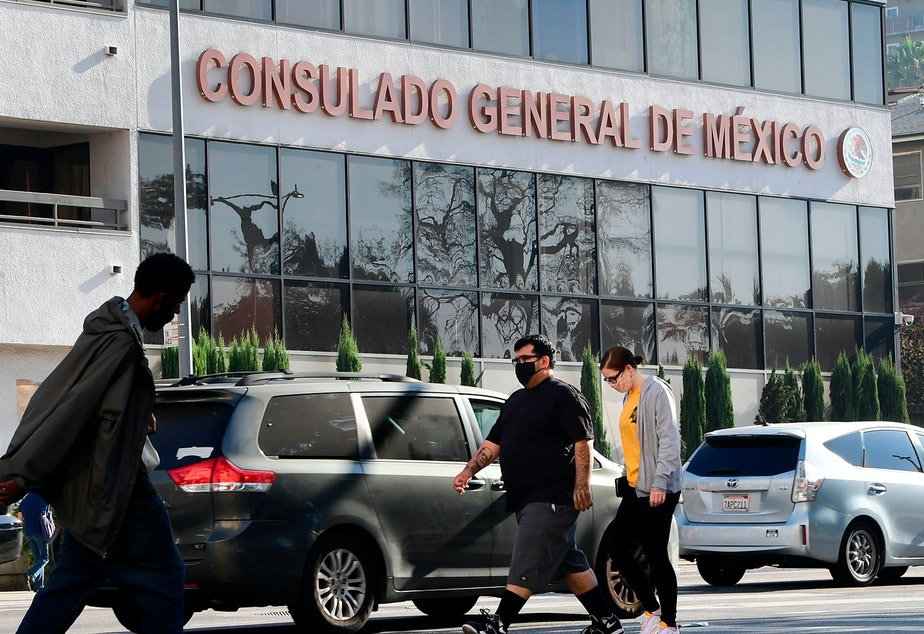 caption: Pedestrians walk past the Consulate General of Mexico in Los Angeles, California on October 16, 2020, a day after former Mexican Secretary of Defense Salvador Cienfuegos was arrested at Los Angeles International Airport at the request of the U.S. Drug Enforcement Administration.